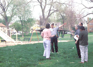 A trained facilitator conducts the place game at Omaha's Gifford Park