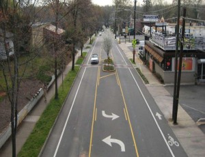 A lane reduction in Charlotte on East Blvd created space for a two-way left turn lane, bike lanes, and a median for a midblock crossing.Photo Credit: City of Charlotte