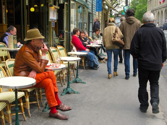 "Activity taking place in Paris cafés embodies the idea of ""eyes on the street"" - Photo by PPS"