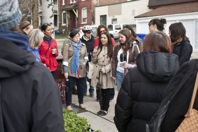A design student leads a walk in Toronto focused on how convenience stores act as a microcosm for each neighborhood they reside in. (Credit: Jane's Walk)